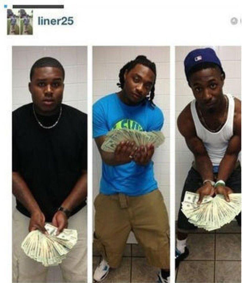 Alabama DE Dee Liner flashes wad of cash in Instagram photo