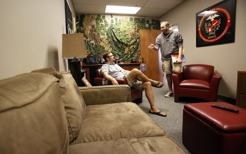 """Former Marines Todd Kennedy, left, and Todd Childs chat in """"The Bunker"""" at the Joan and Art Barron Veterans Center at San Diego State University."""