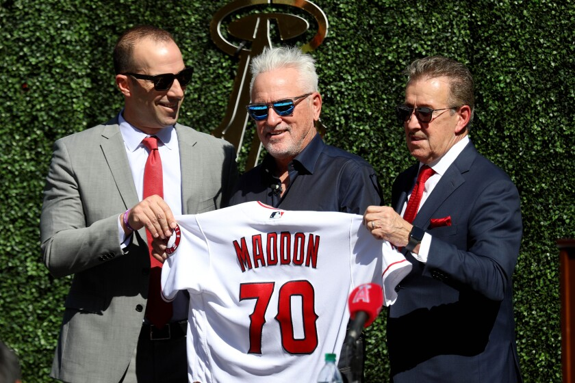 Angels general manager Billy Eppler, left, and team owner Arte Moreno, right, formally introduce Joe Maddon as the team's new manager.