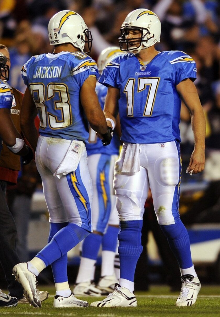 Chargers Vincent Jackson and Philip Rivers celebrate their  third touchdown on Thursday, Dec. 16, 2010.