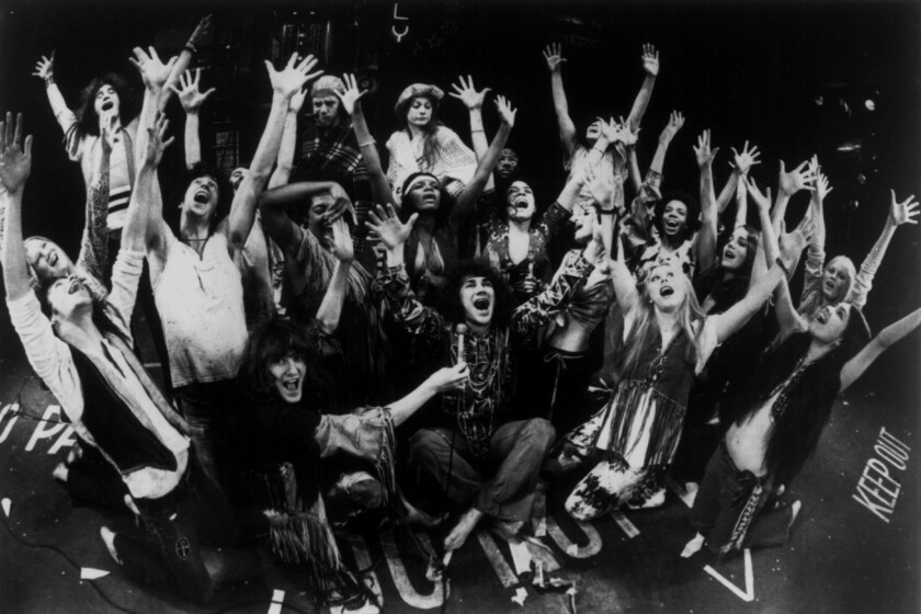 """Hair,"" the rock musical centered on a tribe of long-haired hippies resisting conscription into the Vietnam War, premiered off-Broadway in 1967. A year later, the war comedy-drama opened on Broadway at the Biltmore Theatre. The Biltmore cast is pictured here."