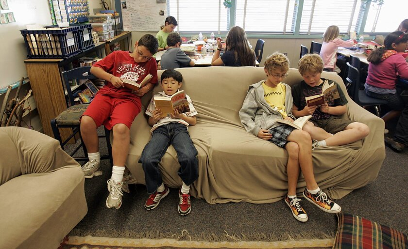 Fourth-graders (from left) Michael Ramirez, Dillan Dao, Adrien Revire and Josh Rosen take on a reading assignment Thursday at Jerabek Elementary School in Scripps Ranch.
