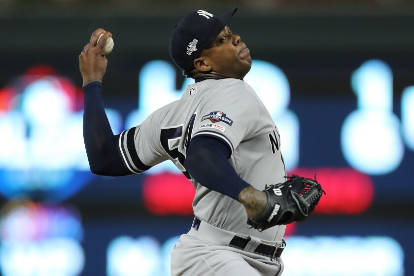Yankees closer Aroldis Chapman delivers a pitch against the Twins during a playoff game last October in Minneapolis.