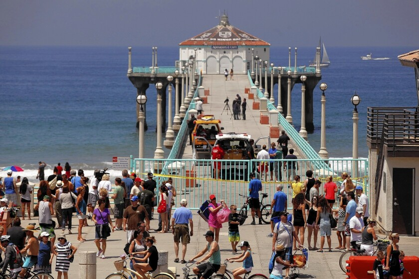 The Manhattan Beach Pier is a popular fishing spot, but after a swimmer was recently bitten by a shark, fishing there has been temporarily banned.