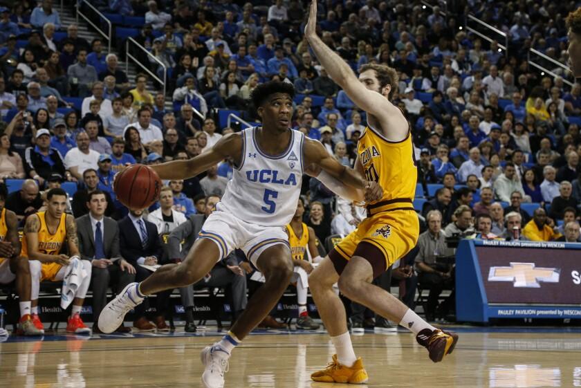 UCLA guard Chris Smith drives against Arizona State forward Mickey Mitchell