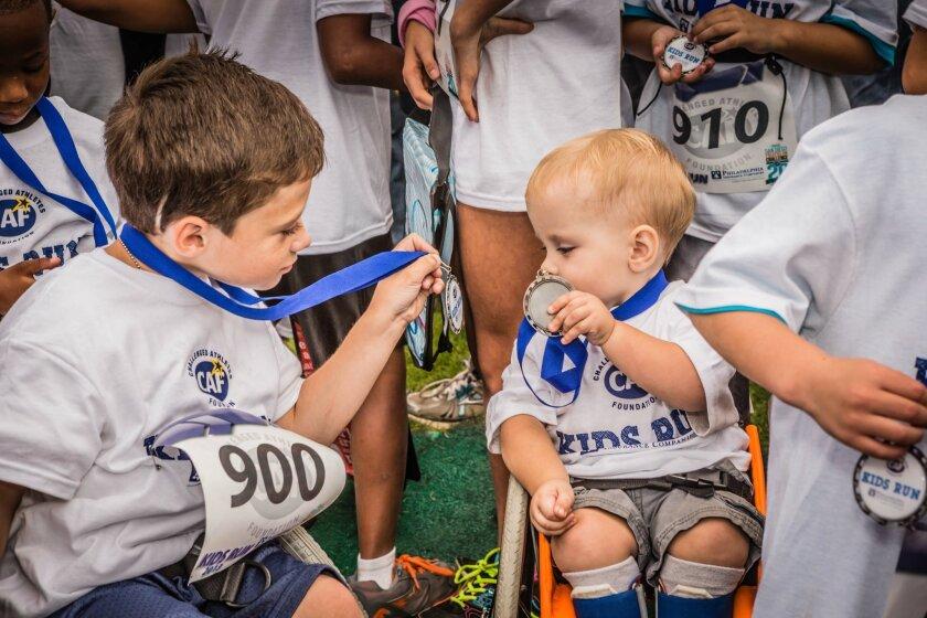 Two very cute little boys after completing the Kids Fun Run last year. Shiggy ichinomiya