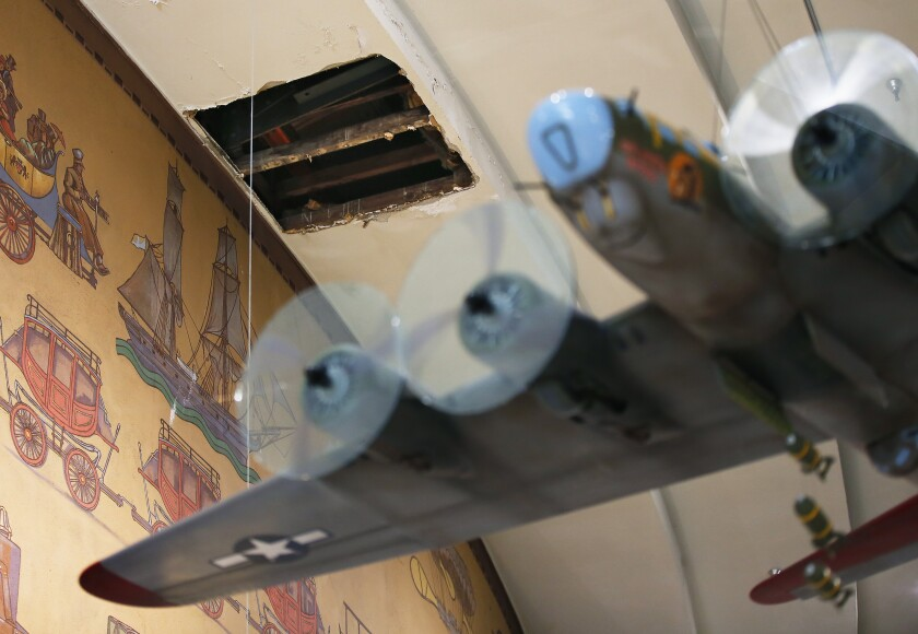 San Diego Mayor Kevin Faulconer directed the $9.3 million that had previously been allocated to the Plaza de Panama project go to a regional parks fund to ensure that those dollars go to other infrastructure priorities in Balboa Park. One of those priorities will be museum roofs such as the one over the San Diego Air and Space Museum. Here, a hole is shown in the ceiling of the museum due to leaks in the roof.