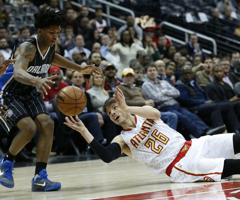 Orlando Magic guard Elfrid Payton (4) recovers the ball after Atlanta Hawks guard Kyle Korver (26) lost control of it in the second half of an NBA basketball game Monday, Feb. 8, 2016, in Atlanta. Orlando won 117-110 in overtime. (AP Photo/John Bazemore)