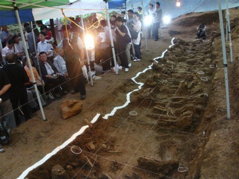 This July 7, 2008, photo released by South Korea's Truth and Reconciliation Commission shows human skeletons unearthed at a site in Gongju, South Korea. Shutting down its inquiry into South Korea's hidden history, a century of human rights abuses, the commission will leave unexplored scores of othe