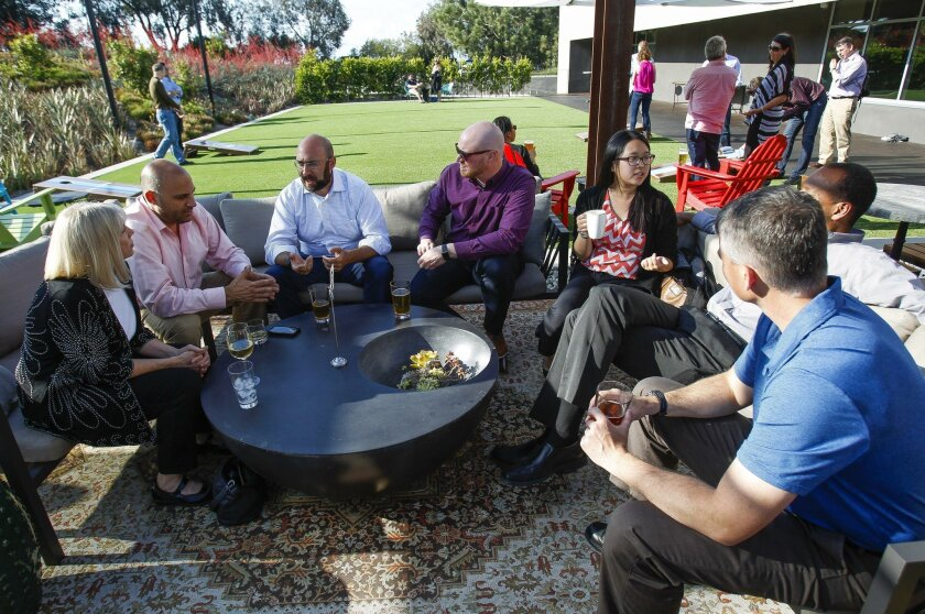 A group sits together at Alexandria Real Estate's $25 million restaurant, gym, and conference center in Torrey Pines Mesa.
