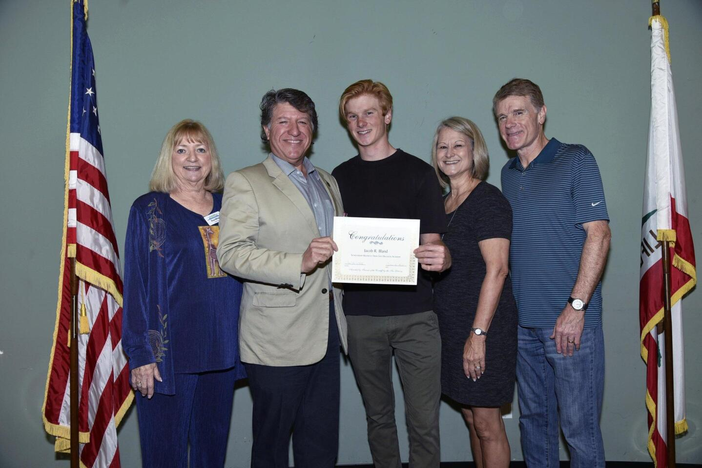 2018 Scholarship Committee member Rose White, County Library Director Migell Acosta, scholarship recipient Jacob Bland, Sarita and Bill Bland