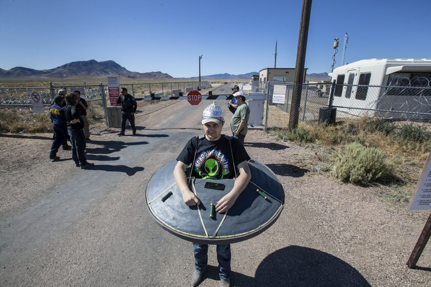 A man in a flying saucer costume