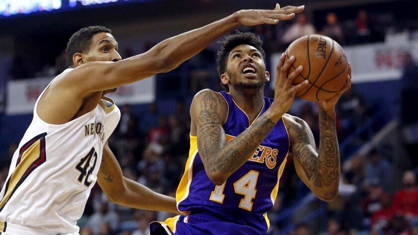 Lakers forward Brandon Ingram drives to the basket against Pelicans center Alexis Ajinca during the first half Saturday.