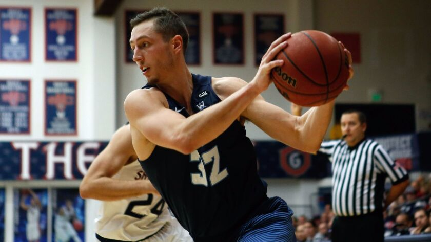 Toreros forward Brett Bailey drives the ball against the St. Mary's Gaels during the second half at McKeon Pavilion on Saturday night. Bailey had 19 points.