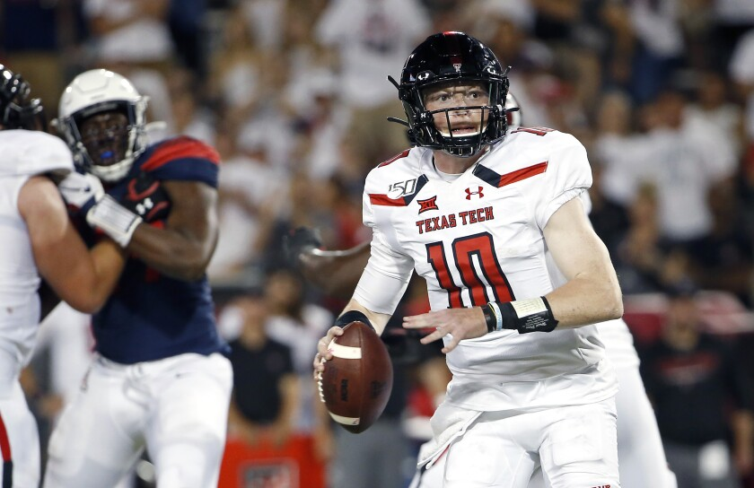 FILE - In this Sept. 14, 2019, file photo, Texas Tech quarterback Alan Bowman (10) looks for a receiver during the second half of the team's NCAA college football game against Arizona in Tucson, Ariz. Bowman is ready for a fresh start as Texas Tech's quarterback. This time, he'd like to be playing at the end of a full season. Bowman likely could have returned from a broken collarbone to play in Texas Tech's final two games last season. He opted instead to save a year of eligibility and turn his focus toward 2020. (AP Photo/Ralph Freso, File)