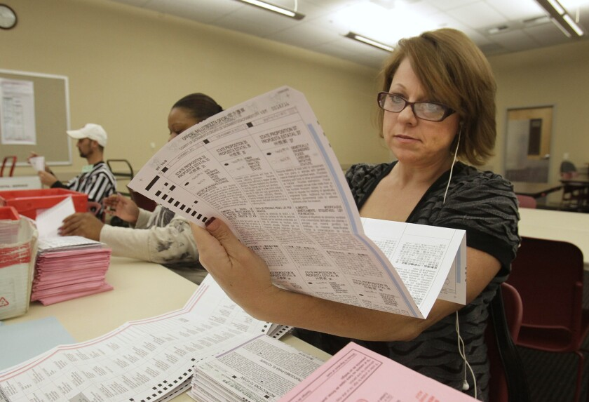 Victoria Williams processes a mail-in ballot at the Sacramento County Registrar of Voters office in the state capital in 2012.
