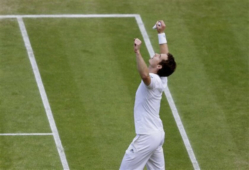 Andy Murray of Britain reacts after defeating Fernando Verdasco of Spain in their Men's singles quarterfinal match at the All England Lawn Tennis Championships in Wimbledon, London, Wednesday, July 3, 2013. (AP Photo/Alastair Grant)