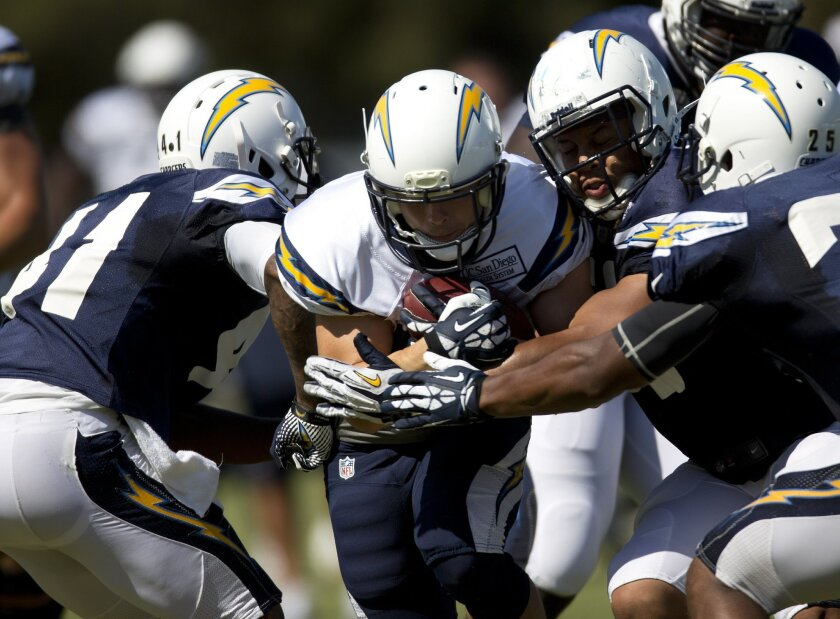July 28,  2013--  San Diego, Ca --   Running back Danny Woodhead plows through the defense during Chargers training camp at Chargers Park Sunday afternoon.   Photo by Earnie Grafton/UT San Diego. Copyright UT San Diego 2013.