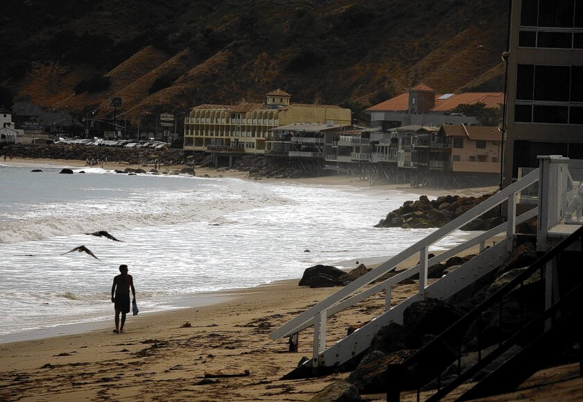 Robert Bernard walks along Carbon Beach in Malibu in 2011. After a decade of fighting, a judge ordered Malibu resident Lisette Ackerberg to create a public access pathway through her property.