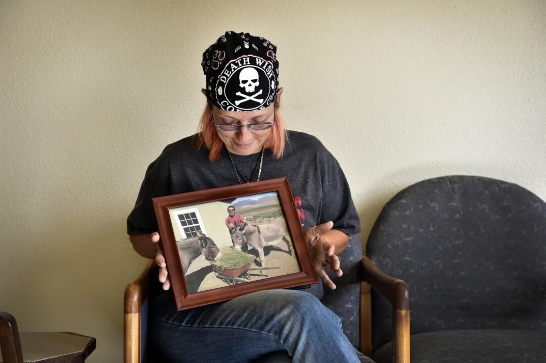 Melissa Edgecomb displays a photo of Tommy Cash Cosman
