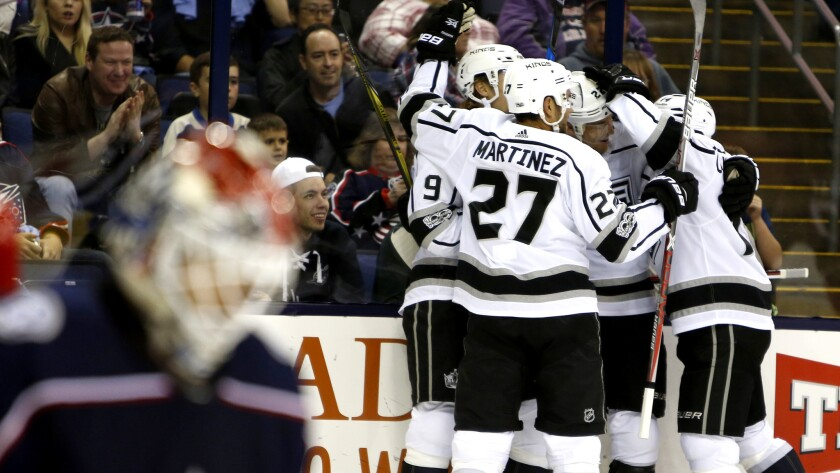 Los Angeles Kings players celebrate their goal against the Columbus Blue Jackets during the first pe