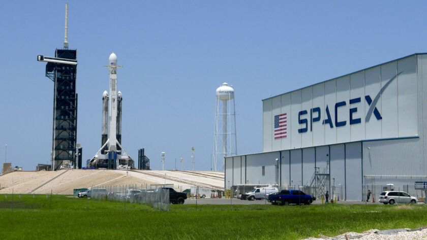 A SpaceX Falcon heavy rocket stands ready for launch at the Kennedy Space Center in Cape Canaveral, Fla., in June. Monday's fire was at a different facility.