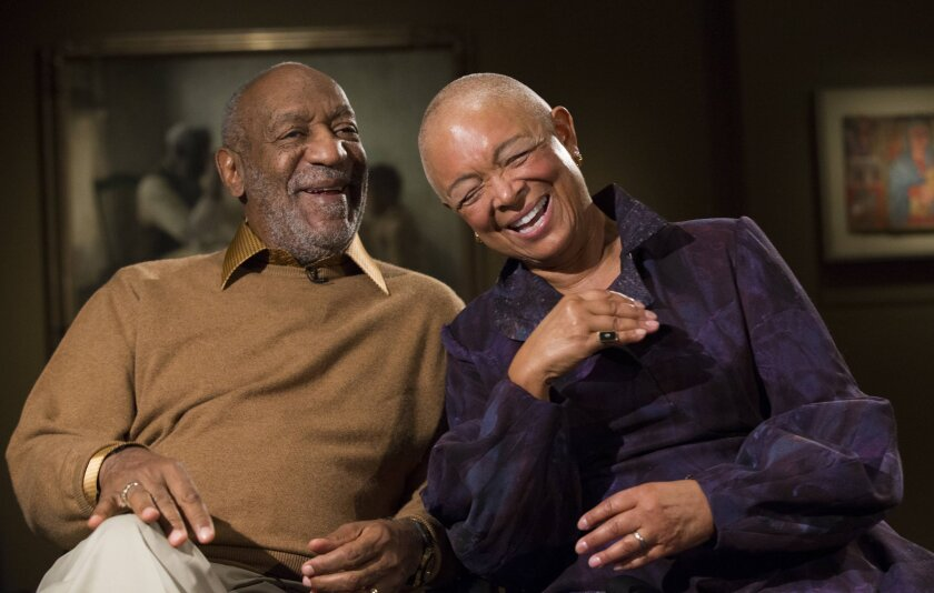 Bill Cosby and his wife, Camille, laugh Nov. 6 as they tell a story about collecting one of the pieces in an exhibit at the Smithsonian's National Museum of African Art in Washington.