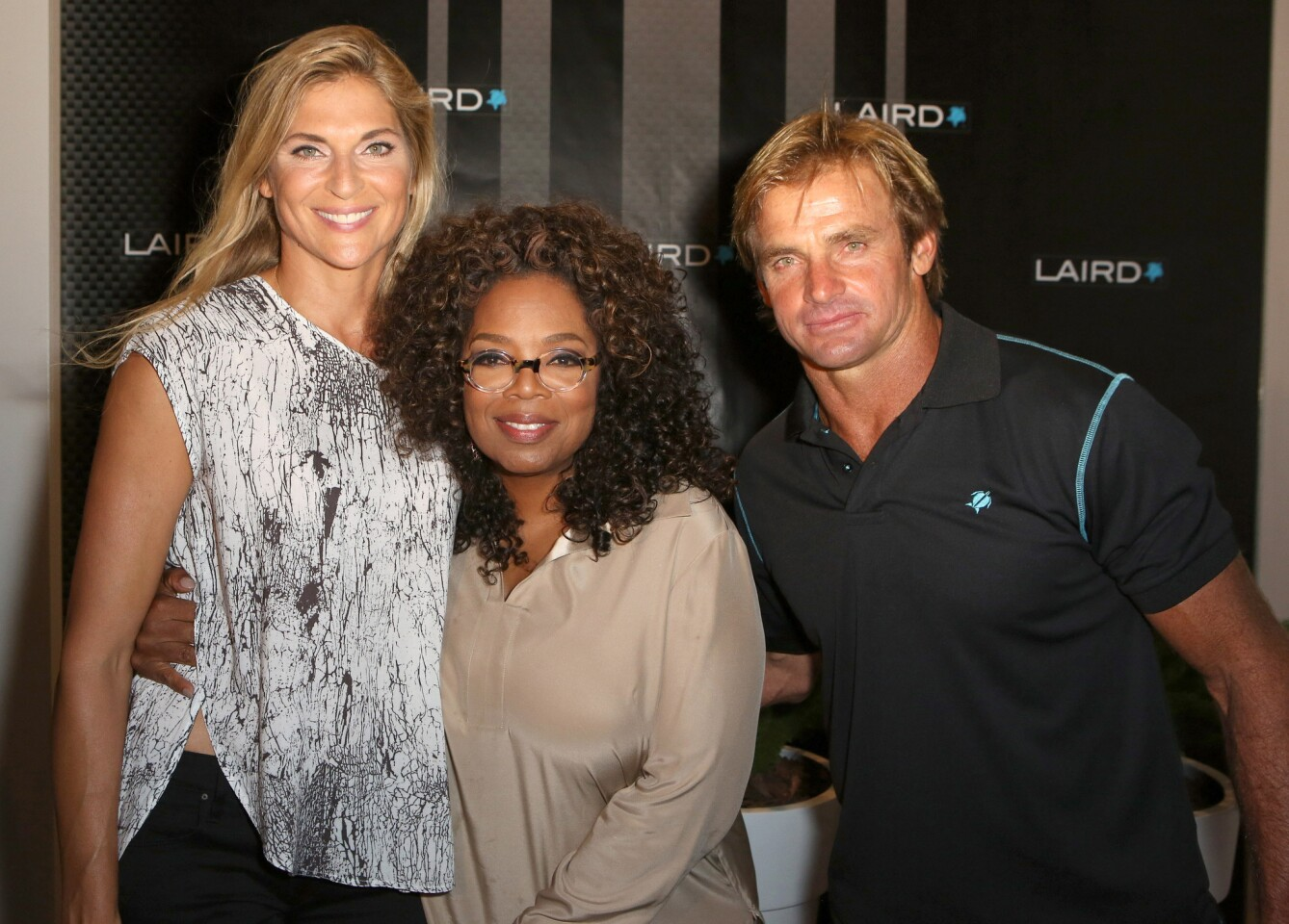 Professional volleyball player Gabrielle Reece (who also happens to be Laird Hamilton's wife), Oprah Winfrey and professional surfer Laird Hamilton at the Oct. 22 launch party of Laird Apparel at Ron Robinson Santa Monica.