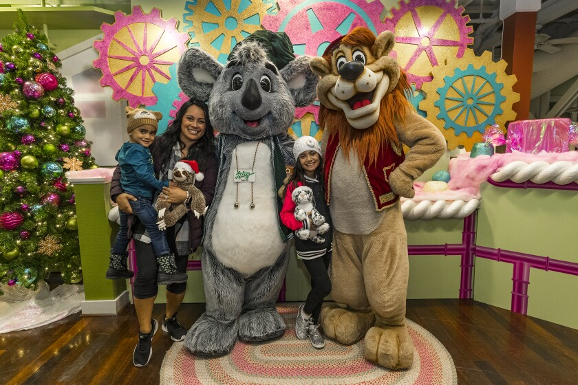 Snap a picture with larger-than-life, friendly zoo characters like Dr. Harry Lion and Sydney Koala at the San Diego Zoo's Jungle Bells.