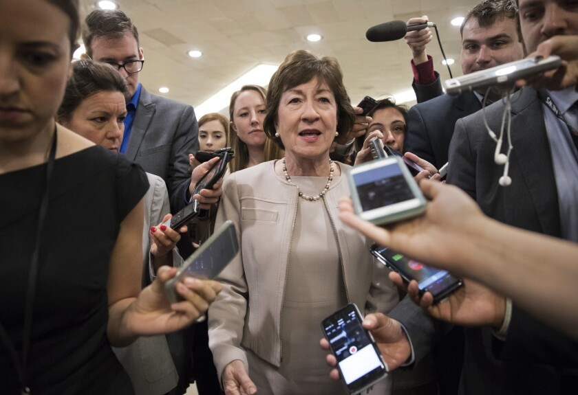 """In this July 25, 2017, photo, Sen. Susan Collins, a Republican form Maine, is surrounded by reporters as she arrives on Capitol Hill in Washington before a test vote on the Republican health care bill. Collins, who was one of three Republican senators voting against the GOP health bill on July 28, said she's troubled by Trump's suggestions that the insurance payments are a """"bailout."""""""