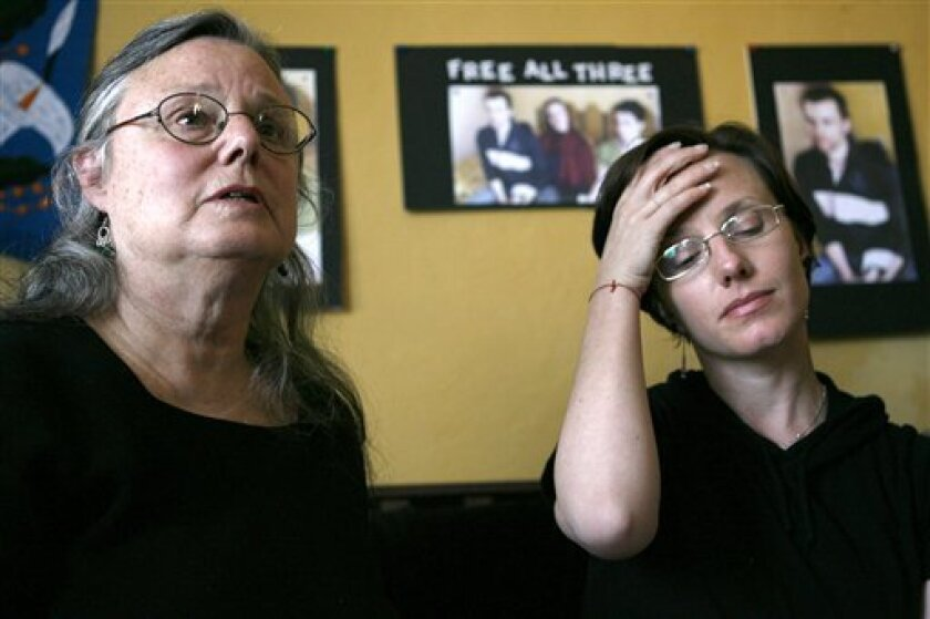 Nora Shourd, left, along with her daughter, Sarah Shourd, speak to the media, Saturday, Oct. 9, 2010 in Oakland, Calif. Sarah Shourd recently freed by Iran said Saturday she is still haunted by images of her friend and fiance in their cramped jail cells and won't have her life back until they have been released. (AP Photo/Dino Vournas)
