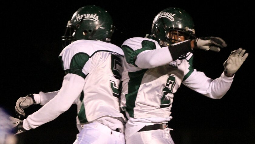 Tyrell (left) and Tyree Robinson played offense and defense for Lincoln, but they could be moved to offense or defense at Oregon.