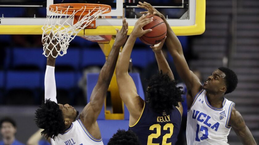 UCLA guard Kris Wilkes (13) blocks a shot by California forward Andre Kelly during the second half Saturday.