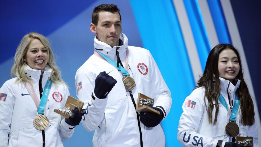 Chris Knierim and wife Alexa (left) with their Olympic bronze medals from figure skating's team competition.
