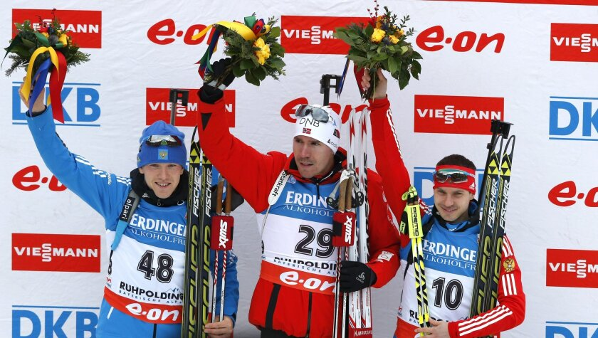 Norway's Emil Hegle Svendsen, center, celebrates on the podium with second placed Russian Alexey Volkov, left, and third placed Evgeny Ustyugov also from Russia, after the men's Individual 20 km competition at the Biathlon World Cup in Ruhpolding, Germany, Saturday, Jan, 11, 2014. (AP Photo/Matthias Schrader)