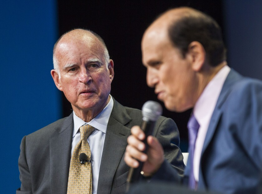 """Jerry Brown looks on as Michael Milken speaks during a discussion titled """"California's Response to Climate Change"""" at the 18th annual Milken Institute Global Conference on April 29, in Beverly Hills."""