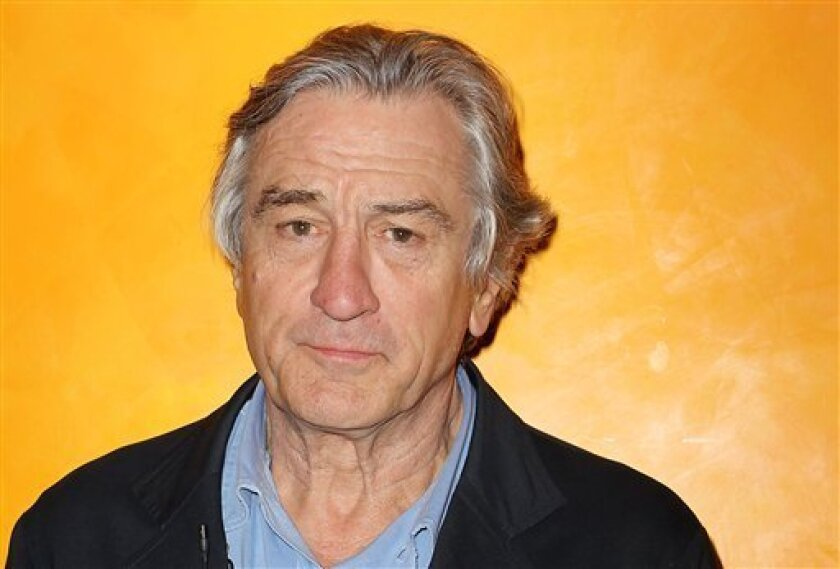 FILE - In this March 13, 2012, file photo Actor Robert De Niro poses for a photo at The Times Center in New York. At a New York fundraiser headlined by first lady Michelle Obama in March, De Niro attempted satire by ticking off the names of the GOP presidential candidates' wives, then joking that A