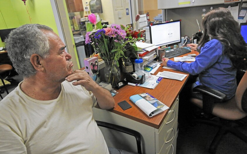 A man signs up for health coverage under the Affordable Care Act in Los Angeles. States that implemented the law saw the biggest drops in uninsured rates, a Gallup poll found.