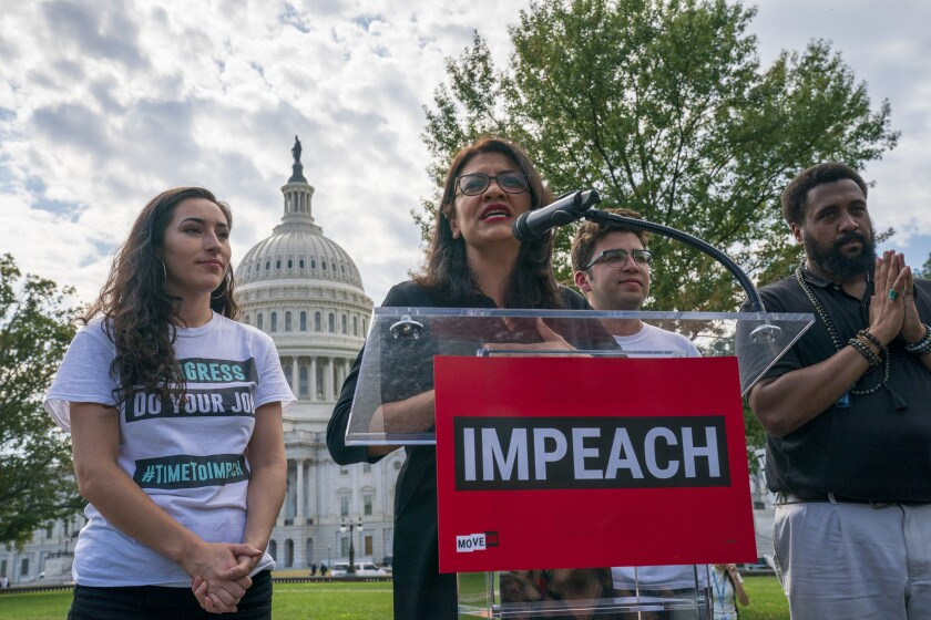 Rep. Rashida Tlaib, D-Mich., a member of the House Committee on Oversight and Reform, speaks as people rally for the impeachment of President Donald Trump, at the Capitol in Washington, Thursday, Sept. 26, 2019. Speaker of the House Nancy Pelosi, D-Calif., committed Tuesday to launching a formal impeachment inquiry against Trump. (AP Photo/J. Scott Applewhite)