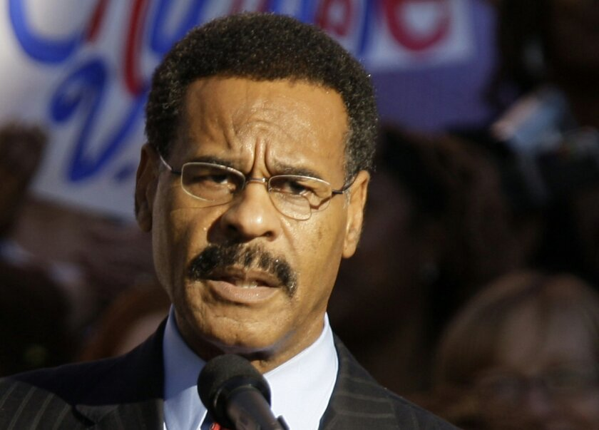 FILE - In this Oct. 1, 2008 file photo Missouri Democratic U.S. Rep. Emanuel Cleaver speaks at a rally in Kansas City, Mo. Federal investigators are looking into what appears to have been an early morning attempt Thursday, Sept. 11, 2014 to firebomb Cleaver's Missouri office. Police say two bottles, with paper towels sticking out of the necks extinguished during flight, were found shattered inside the office below a broken window. There were no staff members in the building at the time. (AP Photo/Charlie Riedel, File)