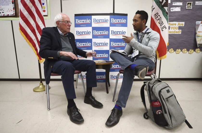 San Diego Union-Tribune reporter Charles Clark interviews Democratic presidential candidate Bernie Sanders in a classroom at San Ysidro High School prior to Sanders' rally at the school on Friday, December 20, 2019 in San Diego, California.
