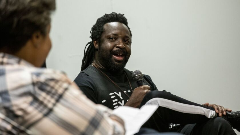 LOS ANGELES, CA --FEBRUARY 20, 2019 --Author Marlon James, right, with writer and editor Roxanne Gay