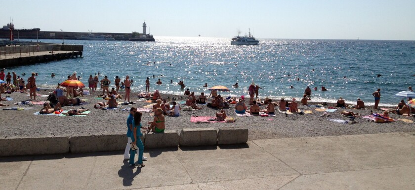 The beach in Yalta. Though some business owners say more Russians are flocking to Yalta since Crimea was annexed, others say higher prices are hurting business.