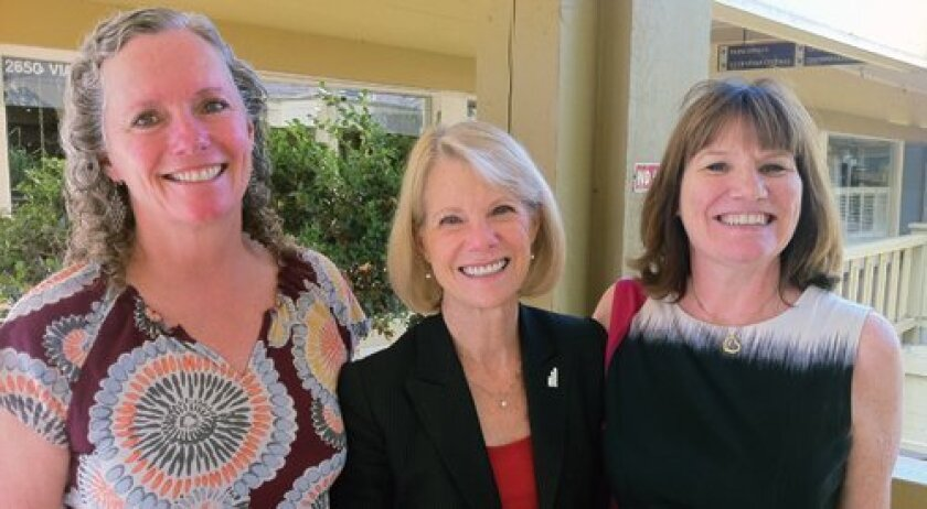 From left: Julie Ruedi, Catherine Blair and Teresa Jacques serve on the 20-member board of the San Diego Women's Foundation. The three Del Mar residents say being part of the philanthropic group has made numerous positive changes in their lives. Photo by Claire Harlin