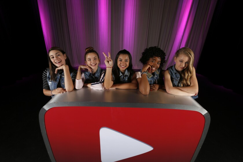 """Mariangeli Collado, left, Jenna Simmons, Tatiana McQuay, McKenzie Mack and Lexi Drew are the stars of YouTube Red's new family series """"Hyperlinked."""" The girls, who perform in the group L2M, star in one of many new shows that YouTube is gearing toward kids."""