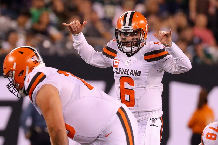 leveland Browns quarterback Baker Mayfield signals at the line.