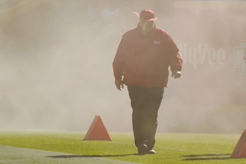 Kansas City Chiefs head coach Andy Reid walks onto the field during team introductions before the first half of an NFL football game against the New York Jets on Sunday, Nov. 1, 2020, in Kansas City, Mo. (AP Photo/Charlie Riedel)