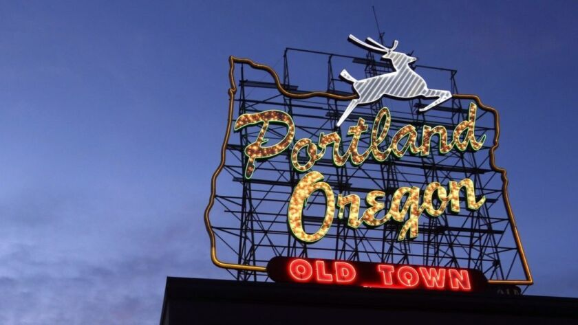 "FILE - In this Jan. 27, 2015, file photo the ""Portland, Oregon"" sign is illuminated in downtown Por"