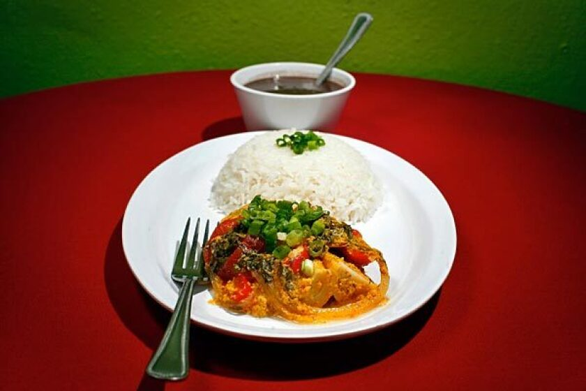 This hearts of palm <i>moqueca</i> includes tomatoes, onions, peppers and coconut milk.