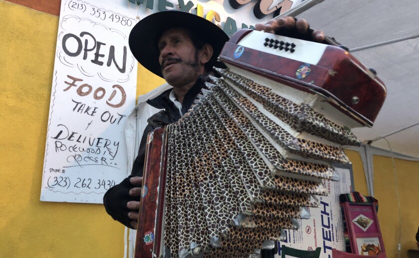 César Villanueva, originally from Guatemala, plays accordion in the duet.